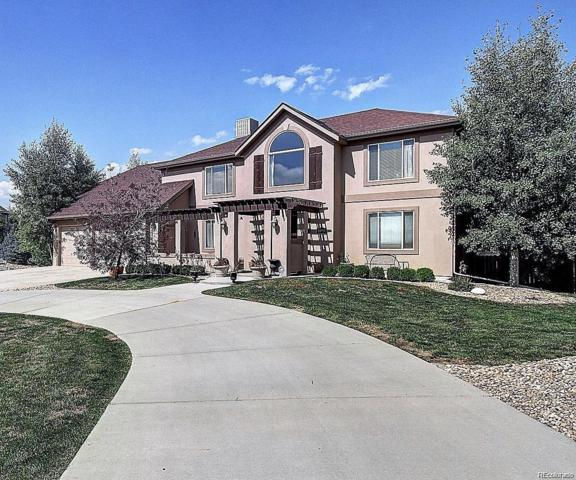 14091 W 63rd Place, Arvada, CO 80004 (#3513443) :: The Griffith Home Team