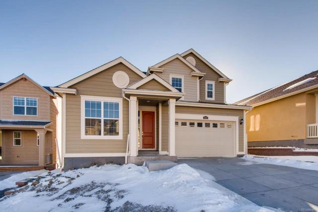 19012 W 84th Place, Arvada, CO 80007 (#3518851) :: The DeGrood Team