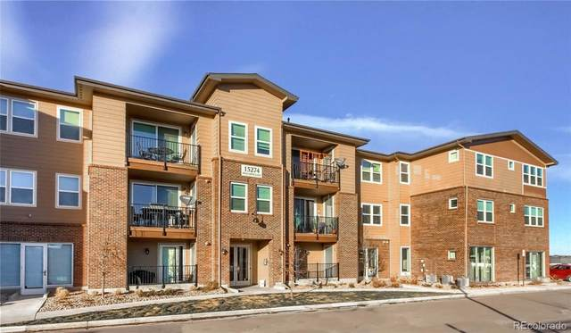 15274 W 64th Lane #102, Arvada, CO 80007 (#3525813) :: The Griffith Home Team