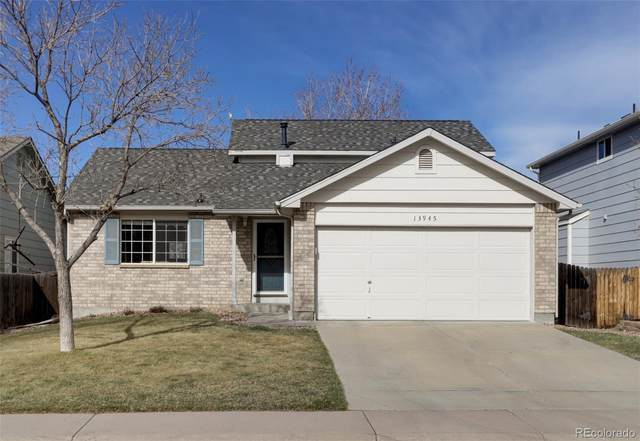13945 Garfield Drive, Thornton, CO 80602 (#3537246) :: Finch & Gable Real Estate Co.