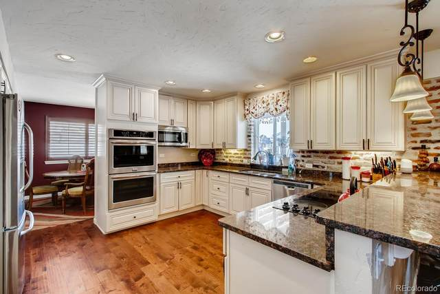 15439 W 77th Drive, Arvada, CO 80007 (#3540177) :: The Healey Group