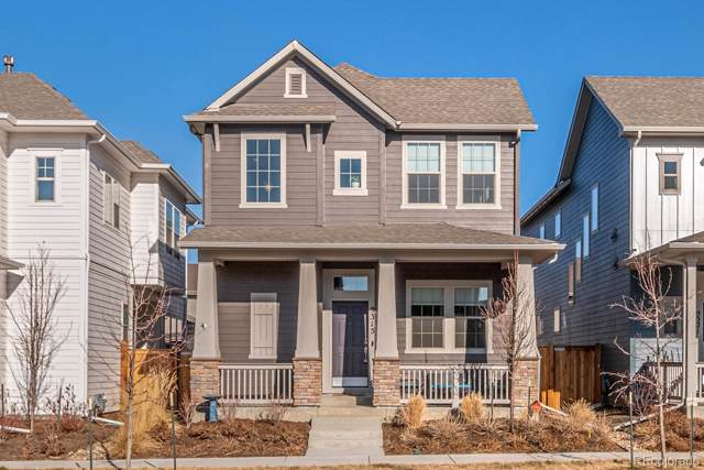 9315 E 58th Avenue, Denver, CO 80238 (#3554945) :: The DeGrood Team