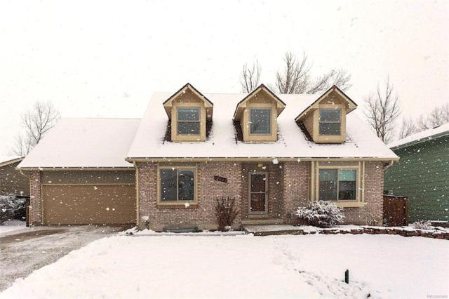 13821 W 66th Way, Arvada, CO 80004 (#3560059) :: The Griffith Home Team