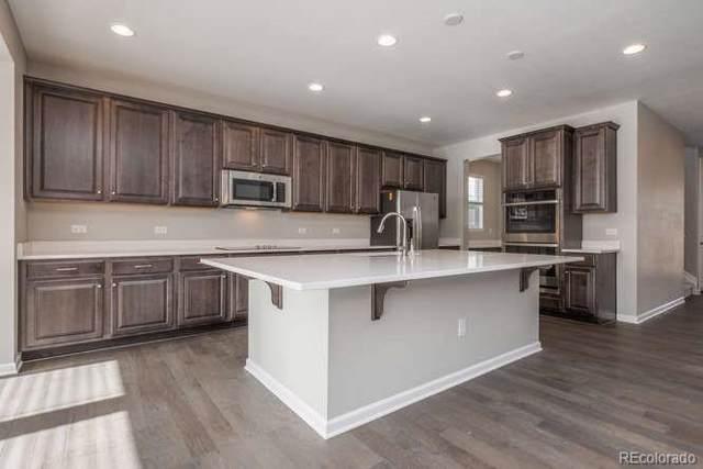 2078 E 151st Avenue, Thornton, CO 80602 (#3574944) :: The Peak Properties Group