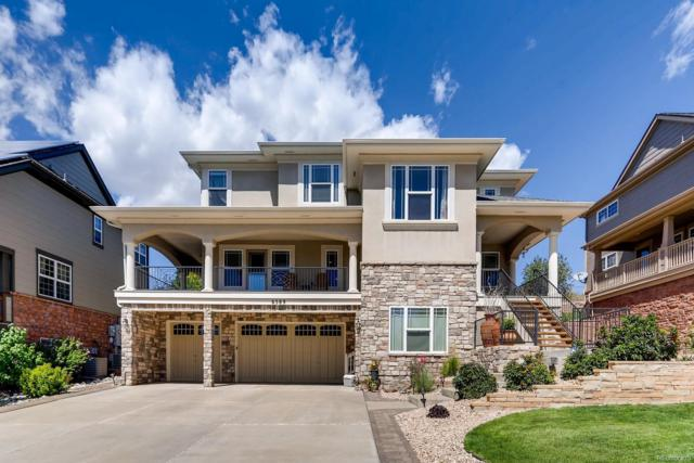 6589 S Versailles Court, Aurora, CO 80016 (#3585724) :: The Heyl Group at Keller Williams