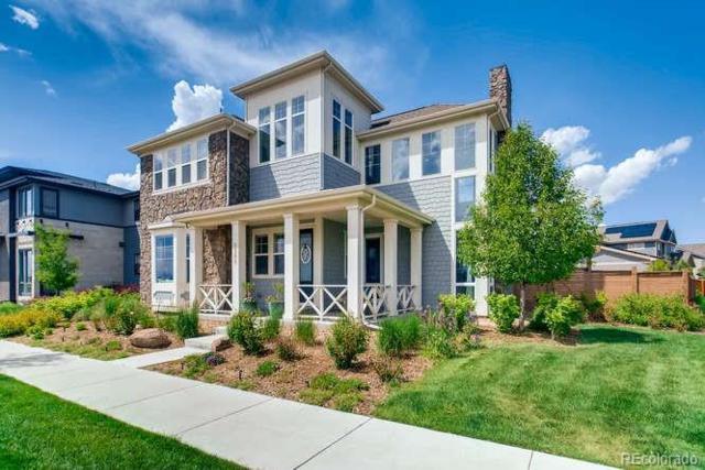 8345 E Prairie Meadow Drive, Denver, CO 80238 (#3608682) :: The Peak Properties Group