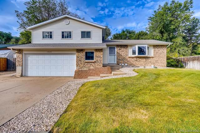 13670 W 69th Place, Arvada, CO 80004 (#3623392) :: The HomeSmiths Team - Keller Williams