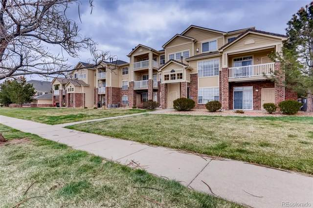 5735 N Genoa Way 11-202, Aurora, CO 80019 (#3634259) :: Hudson Stonegate Team