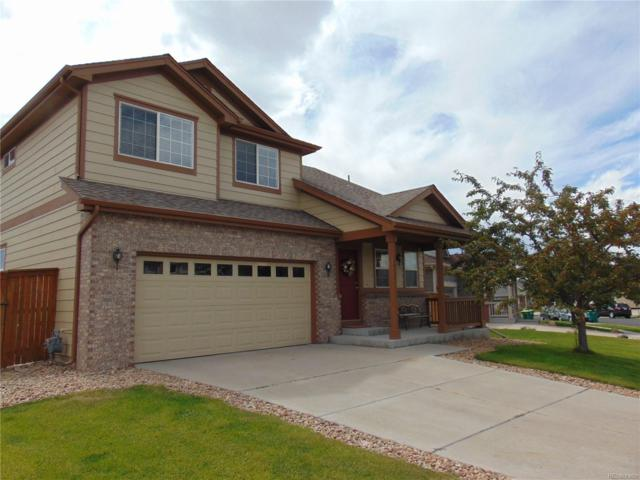 16228 E 105th Way, Commerce City, CO 80022 (#3661486) :: The Peak Properties Group