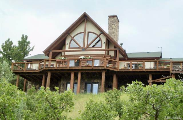 6964 Fox Circle, Larkspur, CO 80118 (#3672541) :: My Home Team