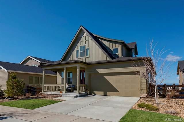 6985 S Buchanan Court, Aurora, CO 80016 (#3682813) :: The Griffith Home Team