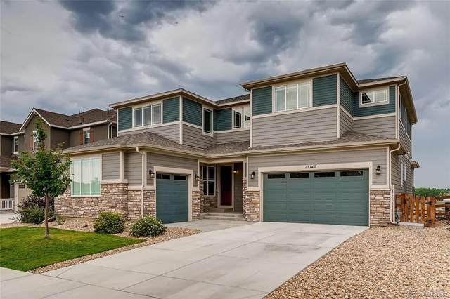 12740 W 73rd Place, Arvada, CO 80005 (#3710700) :: The Healey Group