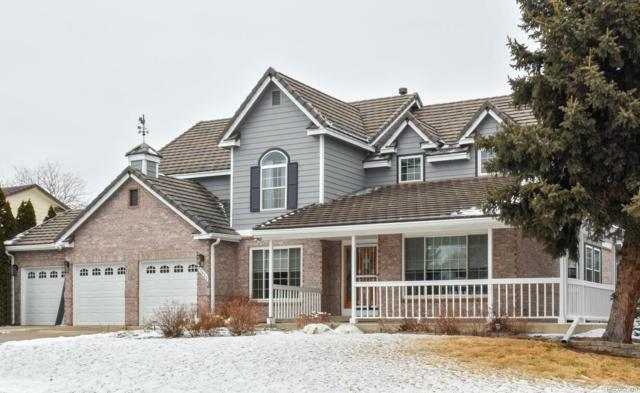 15425 W 72nd Place, Arvada, CO 80007 (#3753882) :: House Hunters Colorado