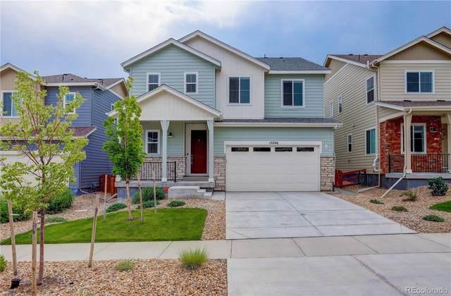 15246 W 93rd Avenue, Arvada, CO 80007 (#3760236) :: Finch & Gable Real Estate Co.