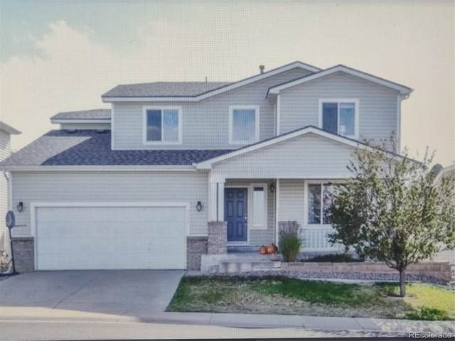 9752 Fox Den Drive, Littleton, CO 80125 (#3785916) :: Peak Properties Group
