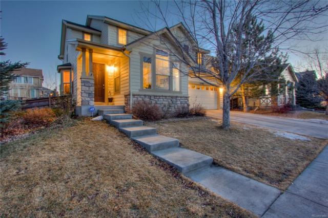17582 E 104th Way, Commerce City, CO 80022 (#3816548) :: The Peak Properties Group