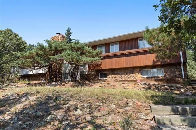 940 W Woodmen Road, Colorado Springs, CO 80919 (#3818724) :: Own-Sweethome Team