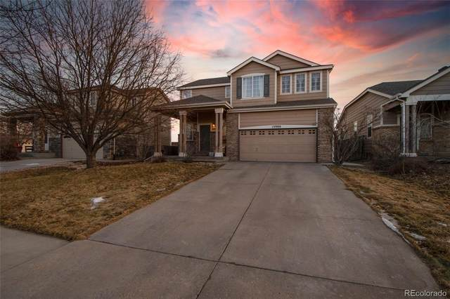 13980 E 104TH Drive, Commerce City, CO 80022 (#3819567) :: The Scott Futa Home Team