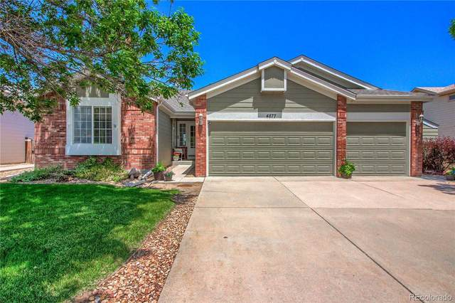 4877 S Danube Way, Aurora, CO 80015 (#3865070) :: Bring Home Denver with Keller Williams Downtown Realty LLC