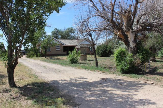 52480 E Colfax Avenue, Strasburg, CO 80136 (#3905878) :: Compass Colorado Realty