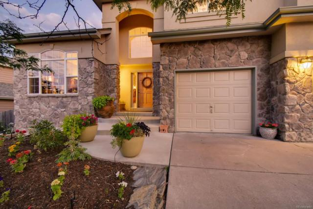 16926 W 71st Place, Arvada, CO 80007 (#3918613) :: House Hunters Colorado