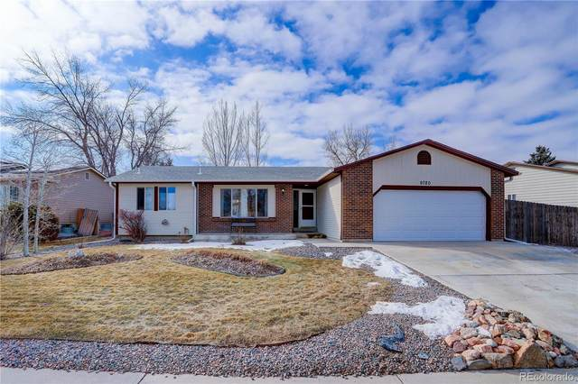 9780 W Wagon Trail Drive, Littleton, CO 80123 (#3927538) :: Kimberly Austin Properties