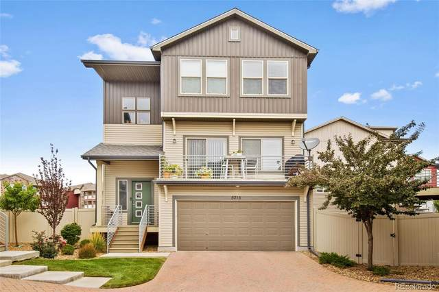 5215 Andes Street, Denver, CO 80249 (#3930008) :: Own-Sweethome Team