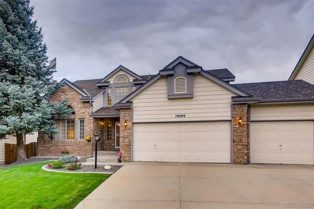 19009 E Low Circle, Aurora, CO 80015 (#3951862) :: Finch & Gable Real Estate Co.