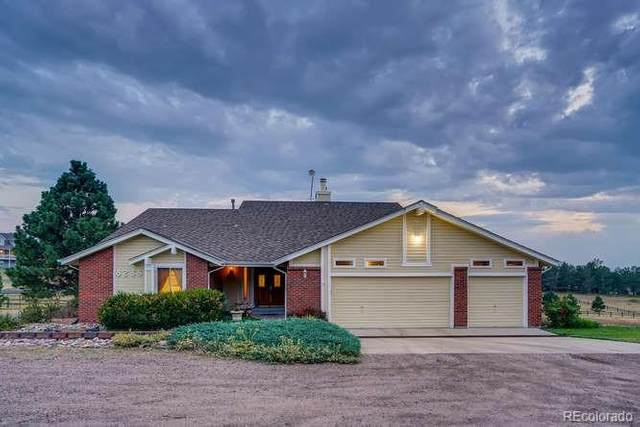8235 S Ireland Way, Aurora, CO 80016 (#3972437) :: The DeGrood Team