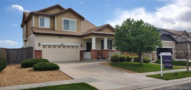 16062 E 107th Avenue, Commerce City, CO 80022 (#3990527) :: The Heyl Group at Keller Williams