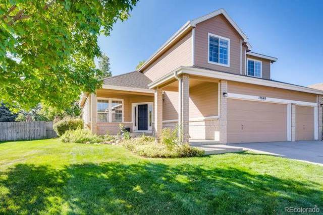 17040 W 64th Drive, Arvada, CO 80007 (#4014789) :: The DeGrood Team