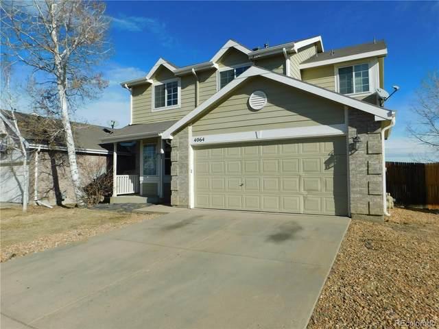 4064 S Himalaya Way, Aurora, CO 80013 (MLS #4043158) :: Neuhaus Real Estate, Inc.