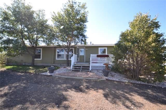4784 County Road L, Wiggins, CO 80654 (#4046604) :: The Peak Properties Group