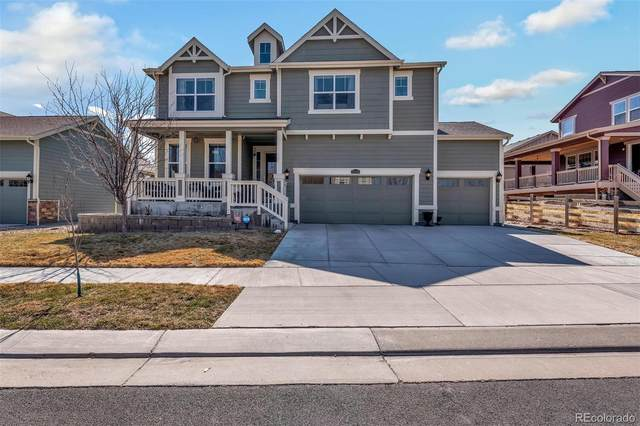 17244 E 105th Way, Commerce City, CO 80022 (#4074784) :: My Home Team