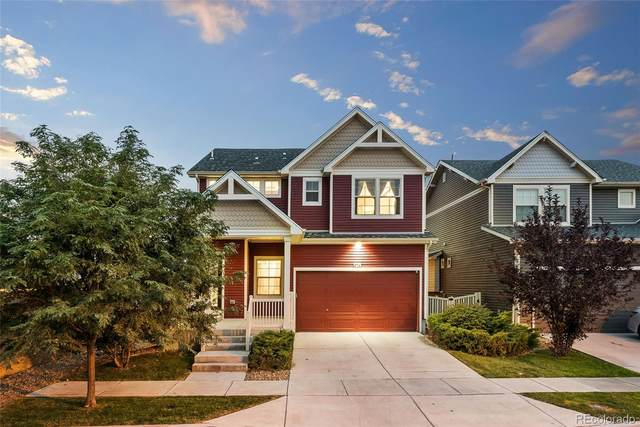 9714 E 105th Avenue, Commerce City, CO 80640 (#4079975) :: The DeGrood Team