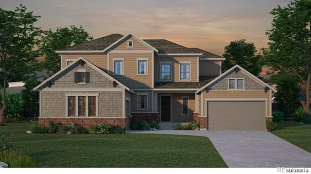 18197 W 95th Avenue, Arvada, CO 80007 (#4131454) :: House Hunters Colorado