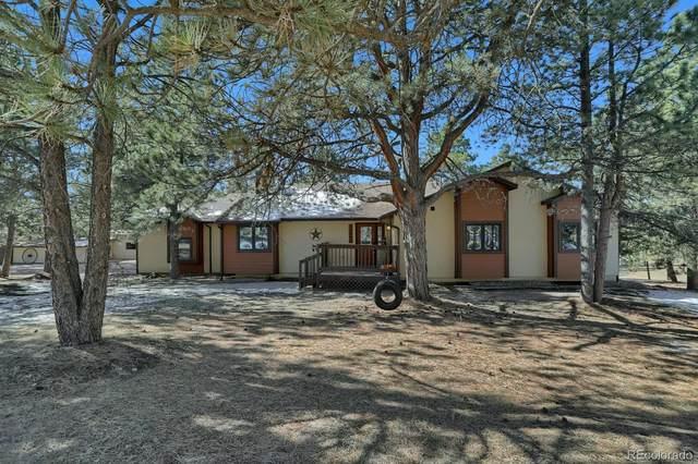 14990 E Coachman Drive, Colorado Springs, CO 80908 (#4136065) :: The DeGrood Team