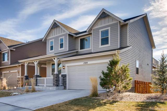 17048 W 87th Avenue, Arvada, CO 80007 (#4137469) :: Compass Colorado Realty