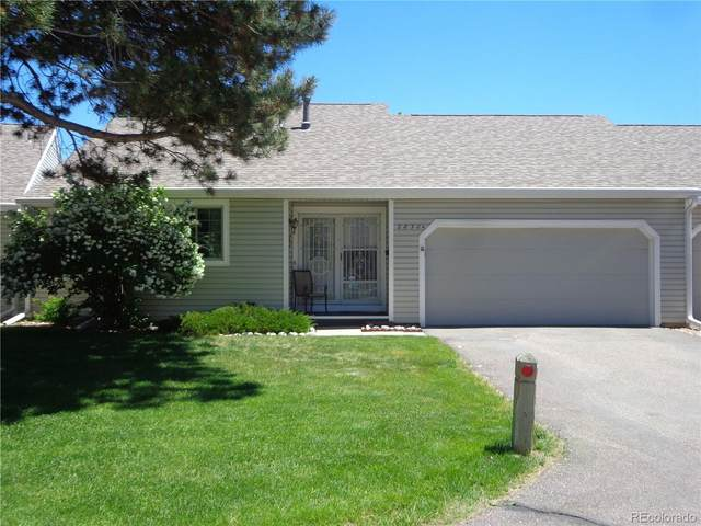 2830 S Heather Gardens Way A, Aurora, CO 80014 (#4152272) :: The Griffith Home Team