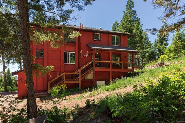 13694 Woodmoor West Drive, Larkspur, CO 80118 (#4184974) :: The Galo Garrido Group