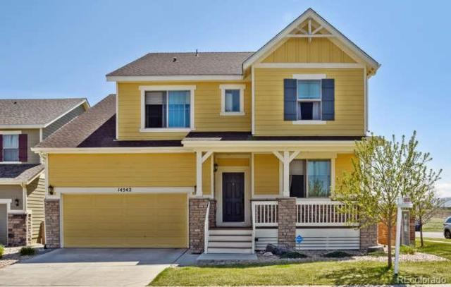 14542 W 85th Lane, Arvada, CO 80005 (#4203206) :: The DeGrood Team
