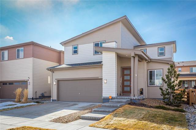 18066 E 107th Way, Commerce City, CO 80022 (#4221427) :: The Peak Properties Group