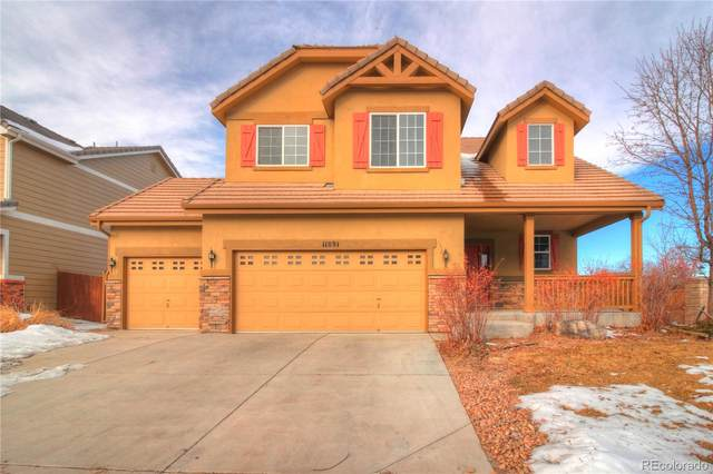 11891 Chambers Drive, Commerce City, CO 80022 (#4238403) :: The Peak Properties Group