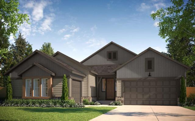 18392 W 93rd Place, Arvada, CO 80007 (#4242148) :: The DeGrood Team
