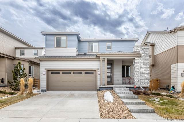 18056 E 107th Way, Commerce City, CO 80022 (#4288708) :: My Home Team
