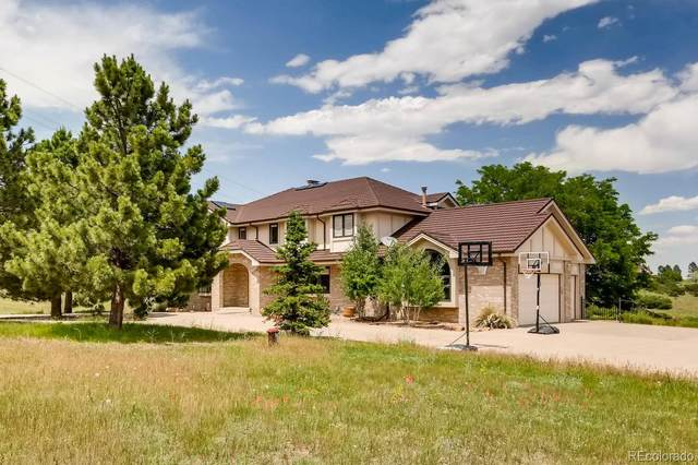 9520 N Heather Drive, Castle Rock, CO 80108 (#4298504) :: The Griffith Home Team