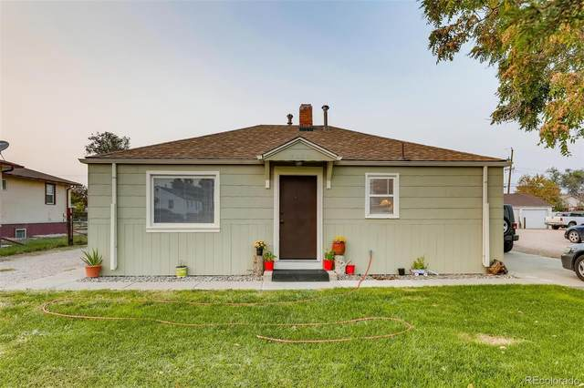 7031 E 69th Place, Commerce City, CO 80022 (#4303582) :: The DeGrood Team