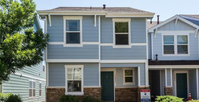 19055 E 57th Place, Denver, CO 80249 (#4317844) :: The Healey Group