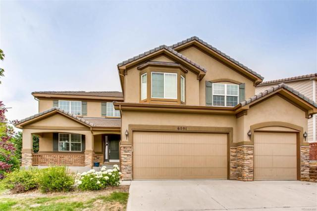 6091 S Oswego Street, Greenwood Village, CO 80111 (#4330850) :: The City and Mountains Group