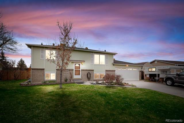 12285 W 71st Place, Arvada, CO 80004 (#4338462) :: The Dixon Group